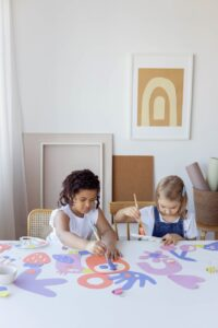 Two kids paintign together