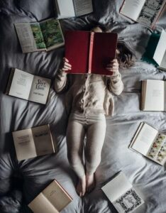 Kid surrounded by books.